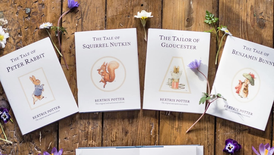 Background image of the classic Peter Rabbit Tales books that sits behind the shop element