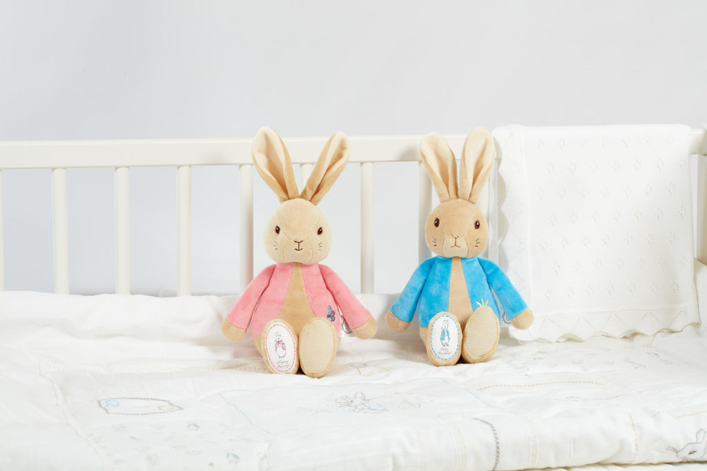 An image of two toys on a bed -part of the award winning World of Peter Rabbit product range